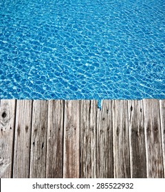 Tropical pool and old wooden pier