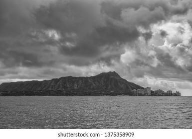 Tropical Rain Storm.  Somber clouds and rain above Diamond Head Crater and Waikiki.