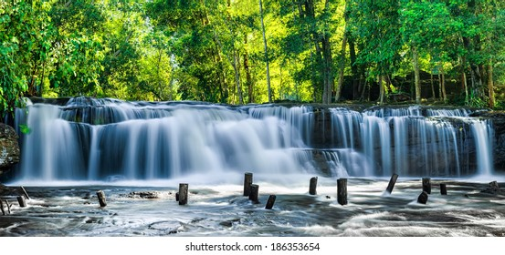 Tropical rainforest landscape with flowing blue water of Kulen waterfall in Cambodia