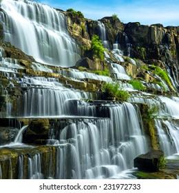 Tropical rainforest landscape with flowing Pongour waterfall. Da Lat, Vietnam