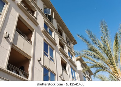 Tropical real estate background with apartments on a clear and sunny day in Playa Vista, California.