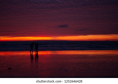 Tropical red sunset with horizon. Benaulim beach, South Goa, India