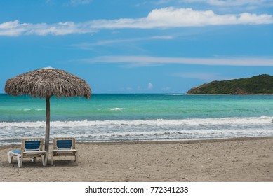 Tropical resort in Caribbean sea with yellow sand and aquamarine water. Manzanillo de Cuba