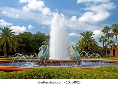 A tropical resort fountain on a sunny summer morning.