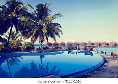 Tropical resort swimming pool and cafe bar near the beach