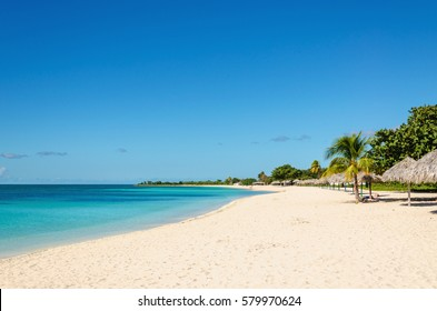 Tropical sandy beach with palm trees, Trinidad, Cuba, Caribbean Islands