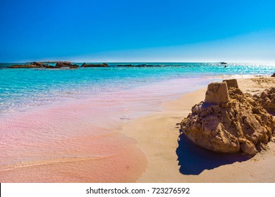 Tropical sandy beach with sandcastles and turquoise water, in Elafonisi, Crete, Greece
