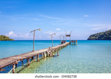 Tropical sea panorama with pier on small island