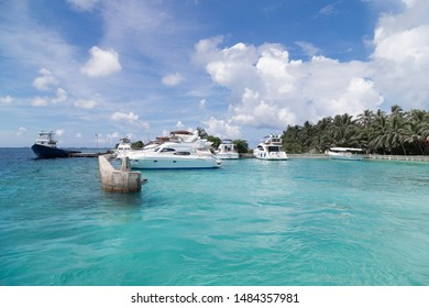 tropical seascape with white boats