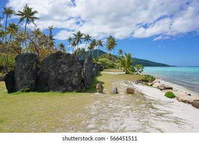 Tropical shore with ancient stone structure, the marae Anini on the south of the island of Huahine Iti, French Polynesia