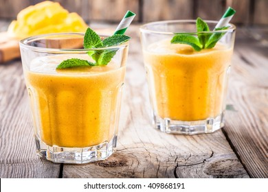 tropical smoothie in a glass with mango and banana