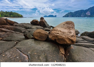 tropical stones beach under cloudy sky. Thailand