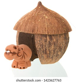 Tropical straw hut with hippo isolated over white background
