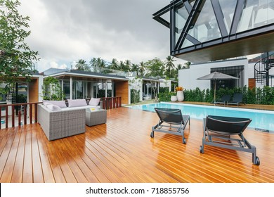 Tropical summer luxury villa interior outdoor. Palm trees, sunny day