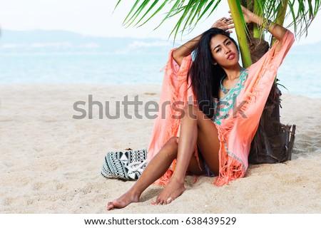 5fe29bd238 Tropical summer portrait of pretty asian young woman in bright beachwear