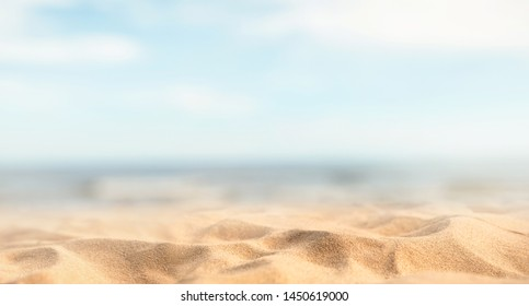 Tropical summer sand beach and bokeh sun light on sea background, copy space.