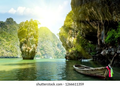 Tropical summer sunset scene cliff James Bond island, Khao Phing Kan Pang Nga bay. Thailand