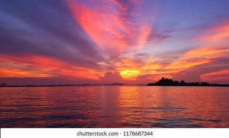 Tropical sunset on the beach. purple sky.