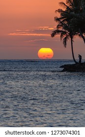 Tropical Sunset Seascape with Palm Trees in Silhouette - Taken on the Coral Coast of Fiji.