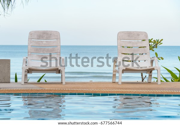 Tropical Swimming Pool Lounge Chairs On Stock Photo (Edit ...