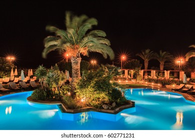 Tropical swimming pool in night view - vacation background