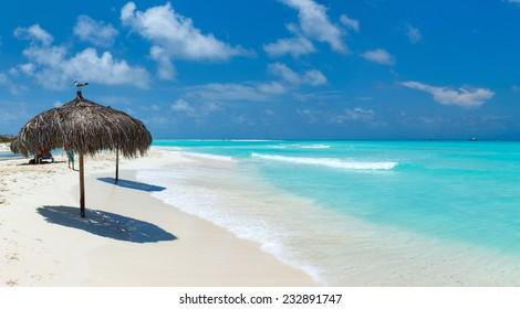 Tropical thatch umbrella on a beautiful Caribbean beach