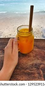Tropical turmeric orange fresh pressed drink