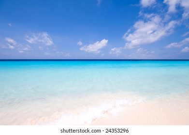 tropical turquoise sea landscape with clouds at horizon