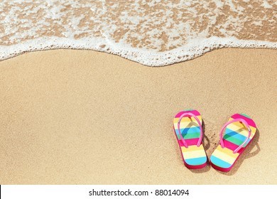 Tropical vacation concept--Flipflops on a sandy ocean beach