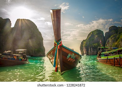 Tropical vacation holiday tourism beach concept. Long tail boat on exotic beach. Krabi, Thailand
