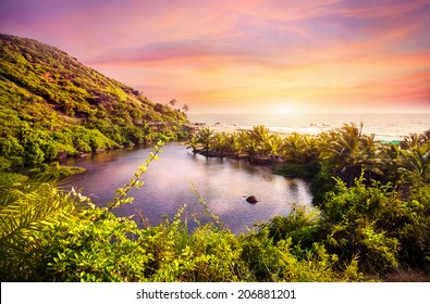 Tropical view to the Sweet Lake on Arambol beach at purple sky in Goa, India
