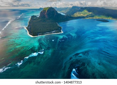 Tropical water, Mauritius island, aerial view of crack in sea bottom, optical illusion of waterfall in clear water
