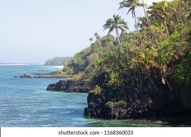 Tropical waters off the coast of a Samoan jungle