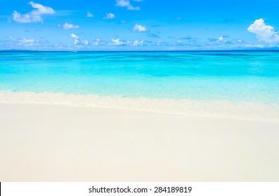 Tropical wave sea on the beach on blue sky background