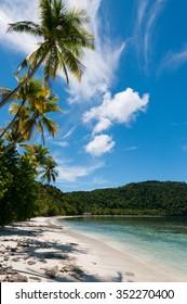 The tropical, white beach of Raja Ampat in Papua New Guinea, Indonesia