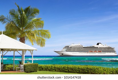 Tropical white gazebo on a sea shore with palm tree and cruise ship in background