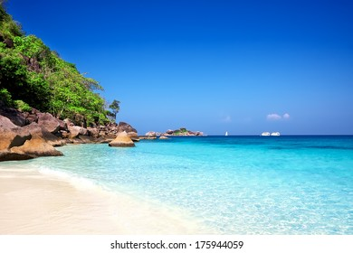 Tropical white sand beach arainst blue sky. Similan islands, Thailand, Phuket.