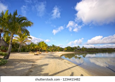 Tropical white sand beach with lounge chairs in Mauritius Island