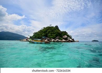 Tropical white sand and blue sea with blue sky at Andaman Sea. Lipe Island, Satun, Thailand.