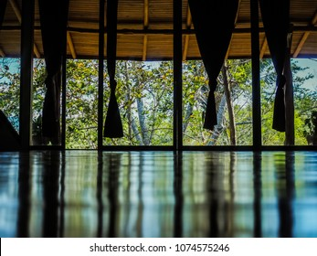 tropical wooden yoga studio place with view outside to the green jungle