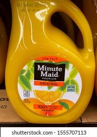 Tropicana Orange juice, low pulp, non gmo, organic on display in the refrigerated section of a grocery store.