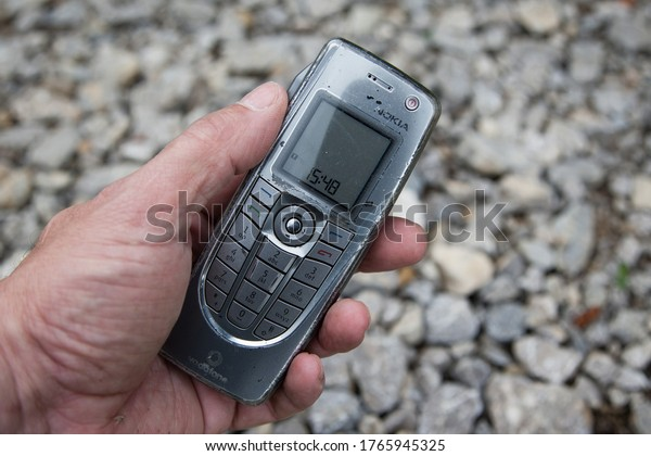Trossingen, Germany, 06/19/2020. A man is holding an old Nokia Communicator 9300i in his hand. The age of smartphones started with these devices and their swiveling keyboard.