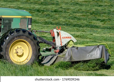 Trossingen, Germany, June 24, 2020. Claas mower in front of a tractor. Modern machines run at high speed and are often a death trap for many young animals.