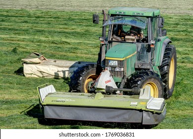 Trossingen, Germany, June 24th, 2020. Farmer during conventional mowing of a grassland area, which leads to the loss of natural habitat and deprives insects of their food and development base.