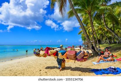Trou-aux-Biches, Mauritius - Jan 4, 2017. Vendors on beach in Trou-aux-Biches, Mauritius. Trou-aux-Biches is a beach-town on the northern coast of Mauritius.