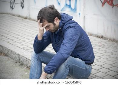 trouble sad man in city street