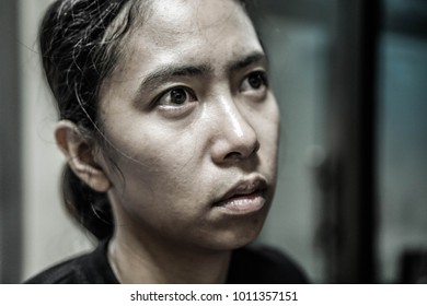 Troubled asian woman thinking worry