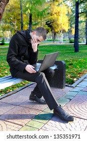 Troubled Man with Laptop at the Autumn Park