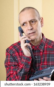 Troubled man speaking about problems on phone