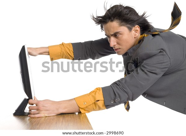 Troubled man's flying in the strong wind. It's blowing from computer's screen. Isolated on white in studio.